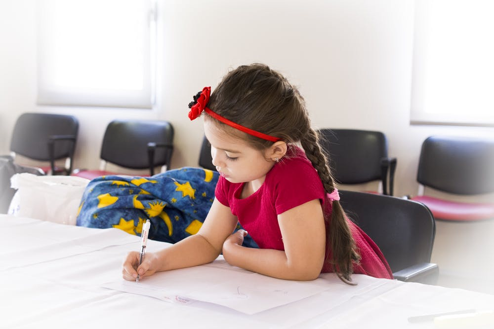 little girl while writing